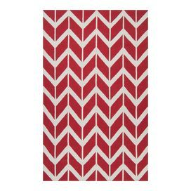 Flatweave wool rug with a chevron motif. Handmade in India.    Product: RugConstruction Material: 100% WoolColor: Red and winter whiteFeatures:  Hand-wovenMade in India Note: Please be aware that actual colors may vary from those shown on your screen. Accent rugs may also not show the entire pattern that the corresponding area rugs have.Cleaning and Care: Blot stains