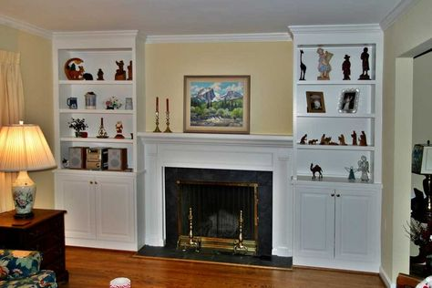 fireplace surrounds with bookcases | Two fireplaces that share an ...