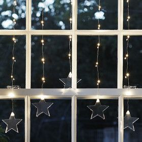 Starry Perfection 5 Strands Of Micro Lights Finished With Stars In A Perfect Arch Curtain Lights Christmas Light