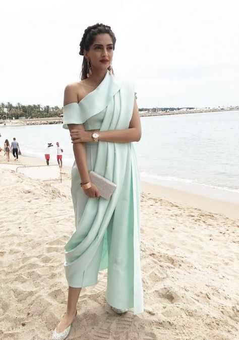 Sonam Kapoor is clicked here on her Day 2 at the Cannes 2017 international film festival. The B-town fashionsta today sported a sea-blue, House of Ma...