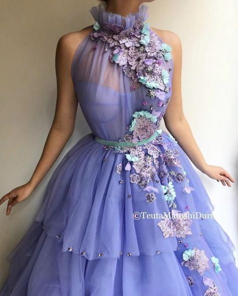Details Purple lilac dress color Tulle dress fabric Handmade embroidered blooming flowers and purple crystals all over the dress Mint velvet belt Ball gown with waist definition For parties and special occasions