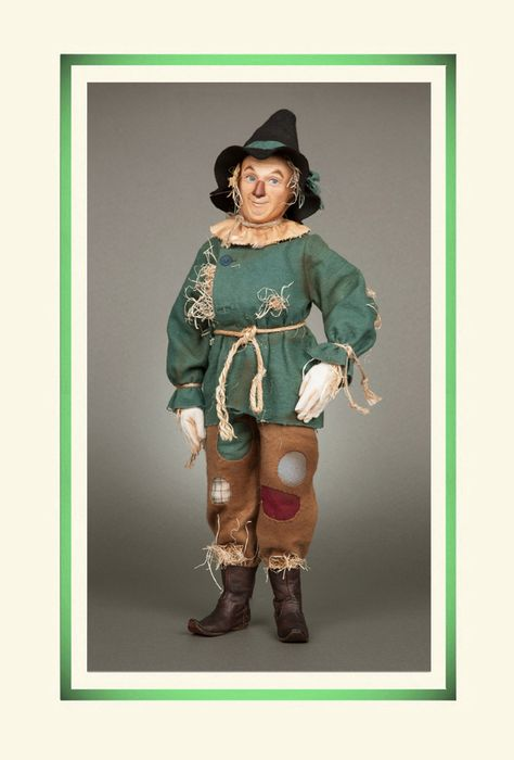 Oz's Scarecrow™ from R. John Wright Dolls is faithfully based on the original motion picture images. Standing 18 inches tall, he is fully jointed at the shoulders, hips, knees, elbows and neck with the R. John Wright ball & socket jointing system with an internal wood mechanism. The molded felt character face has been finely modeled in a true likeness with hand painted features and embossed burlap complexion. #RJWDolls #RJohnWrightDolls #CollectibleDolls
