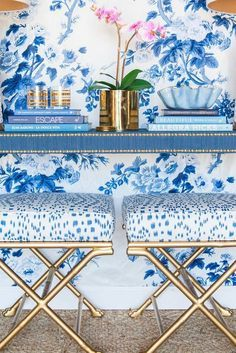 A stunning blue and white vignette - Chinoiserie features include a potted orchid and a grasscloth console table, brass x benches