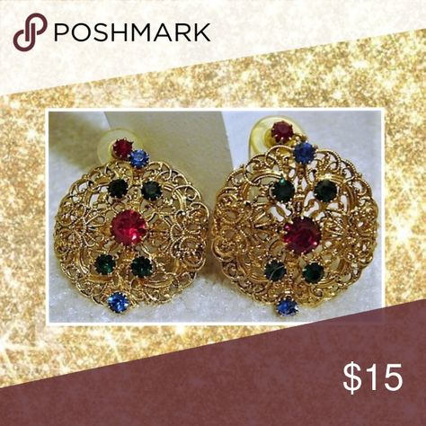 Vintage Gold Rhinestone Post Earrings Vintage Gold Rhinestone Post Earrings. The rhinestones colors are red, green & blue. Excellent condition. Jewelry Earrings