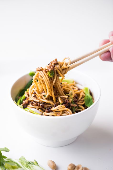 This is the easy 30 minute edition of Dan Dan Noodles ~ spicy Asian noodles in a rich creamy sauce, topped with crispy pork and barely wilted greens, YUM!! #easy #authentic #recipe #chinese #noodles #asian #takeout #pork #noodlebowl #ramen #30minute #dinner #best #healthy #peanutsauce #streetfood #dandan #groundpork #sichuan #chilioil