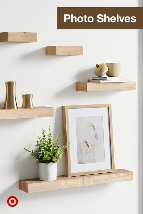 Floating photo shelves add depth  dimension to living room  kitchen walls, plus let you create a chic photo display.