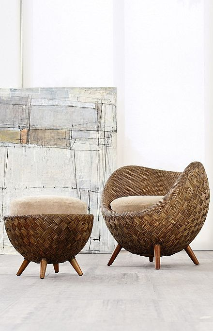 A vignette made up of a rattan chair & ottoman with natural cushions in front of an abstract art canvas. Organic, spare & interesting...V