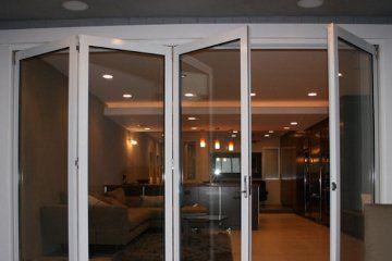 Condo Living Room With Open Concenpt Design Sliding Door Brick Patio Living Room Patio Doors Garage Remodel Garage Door Design