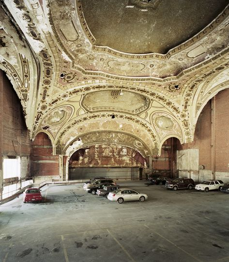 The 1929 Michigan Theater in Detroit now serves as a parking lot, the disonnance between its architecture and current usage symptomatic of the former industrial boom city's inexorable decline; photo Sean Hemmerle