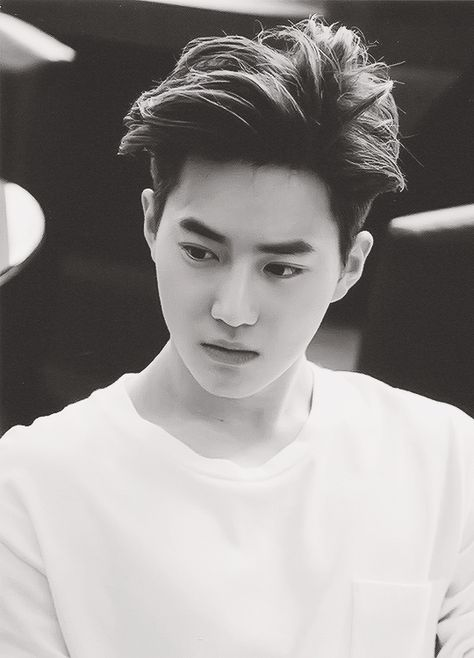Suho, SMILE! DONT LOOK SO MAD! ITS ONLY A LITTLE TINY RULER NOT A CHAIN SAW! BUCK UP!