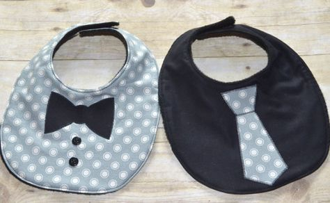 Gray Dots Two Piece Bib Set One Tie Bib and One Bow Tie Bib. This listing is for a two piece set.  Both have the same black fleece on the back.  Ties are an appliqué and sewed on. Buttons are also sewed on. Fits babies up to around 12 months. And even longer as drool bibs. Velcro closure in the back. 9 1/2 inches x 8 inches.  Welcome new baby with this trendy gift, or add to your own babys collection, can never have enough bibs.  Heres another set…
