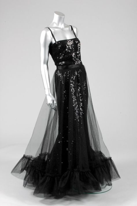 ae1222691a1 Yves Saint Laurent black sequined and tulle evening gown, Autumn-Winter,  1983, comprising black sequined camisole top edged in satin, the columnar  sequined ...