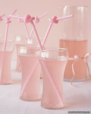 "Straw tied into ""love knots"" put a fresh spin on an old tradition when they embellish drinks at your reception."