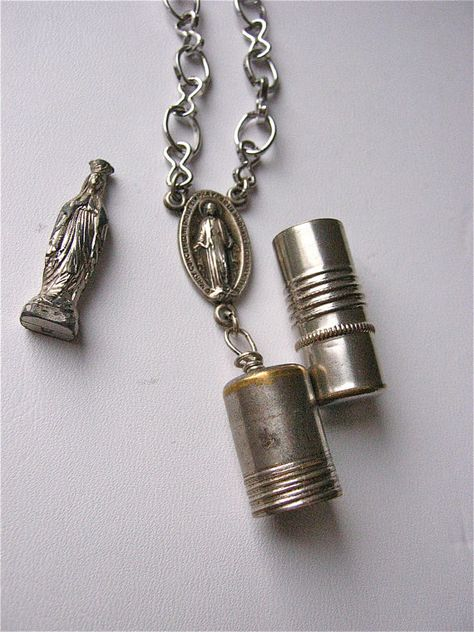 BRASS THIMBLE WITH AN ANGEL DESIGN AFFIXED