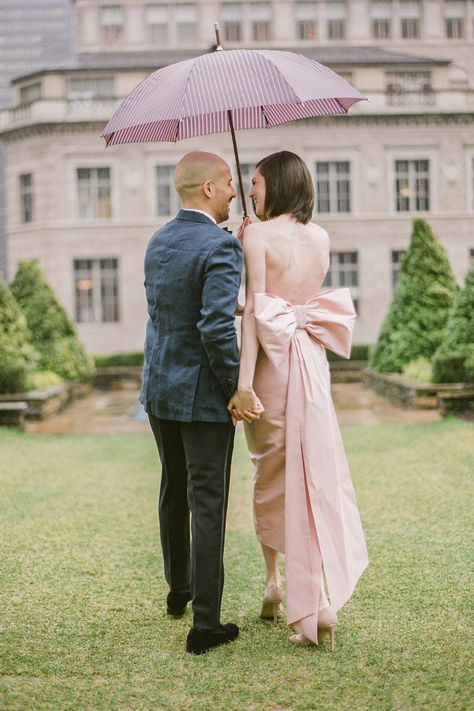 It's not every day that you get to really dress up, so why not (literally) tie your look together with an extra-special detail: a bow!   Photography: @graciebyrdjones #stylemepretty #weddingday #weddingrain #brideandgroom #bowdress