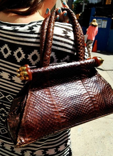 This vintage 40's or 50's brown snake bag with bright brass finales on the snap opening looks to be in excellent shape, with just a few