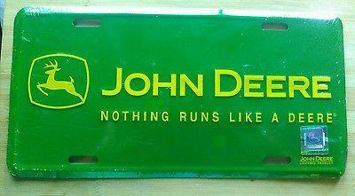 John Deere Nothing Runs Like Green Background Embossed Metal License Plate
