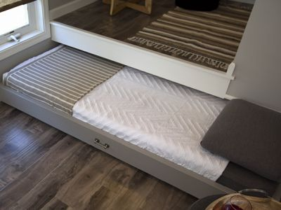 """SLEEPING, NY - """"The bed slides out for sleeping, but hides away under the office space when not in use."""" In this close-up, the full bed is p... http://www.fyi.tv/shows/tiny-house-nation/pictures/tim-and-shannons-tiny-house"""