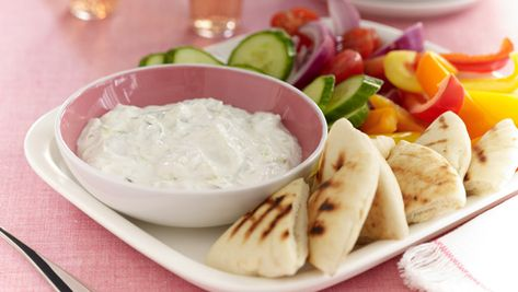 """Molly Ringwald's Tzatziki: """"Speak to me in Greek,"""" I suggested, since I was too nervous to speak myself, let alone breathe, having polished off the entire bowl of tzatziki.  """"Little gold piece,"""" he said in Greek. Then he began listing all of the islands that, as I would later learn, he hoped we would one day visit. At the time I had no clue what he was saying. I was simply luxuriating in the sound of the foreign tongue. """"Santorini. Mykonos. Skiathos…,"""" he murmured in between kisses.  I whispered back one of the few Greek words he'd taught me: the one that means """"more.""""  He said other words I didn't know, but then I heard one I did. I shot up. """"Tzatziki! Are you naming food products?""""  He nodded sheepishly. """"I ran out of islands."""" Turned out he was also naming appliances, political parties, and cartoon characters. And it didn't matter! He could have read me the entire Athenian phone book while we both munched on cloves of garlic as if they were chewing gum. It was definitely a date."""""""