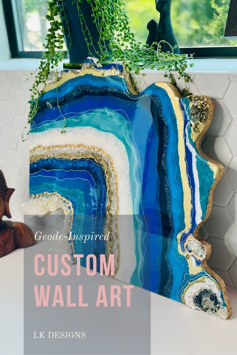 Stunning geode inspired wall art expertly created using epoxy resin, wood base, real quartz crystals, and crushed glass. Check out our site for more unique decor and functional art! #geode #geodeart #resingeode #giantgeode #resinart #epoxyart #geodepainting