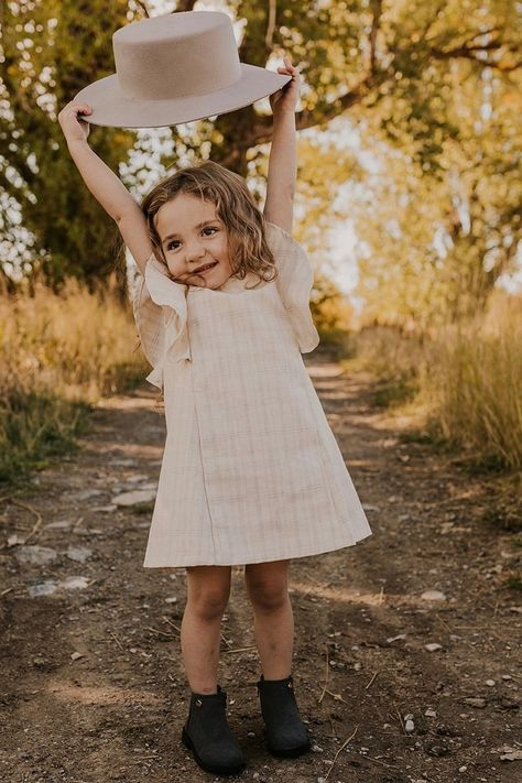 Plaid is the print of fall, so style your girl accordingly with the Corsica Ruffle Dress! This simple cream dress is one of the many great kids clothes at ROOLEE! Girls Fall Outfits, Cute Outfits For Kids, Toddler Girl Outfits, Baby Outfits, Neutral Dress, Blonde Kids, Ruffle Dress, Ruffles, Girl Falling