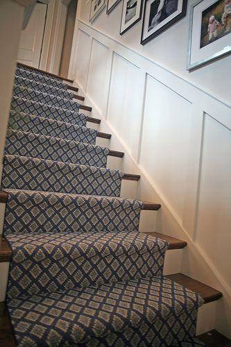 Our stair runner! wainscoting on stairway wall