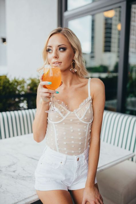 We are crushin' hard on this bodysuit. The Simply Yours Dot Bodysuit in white is perfect paired with a skirt or jeans. We recommend sizing up if you are in between sizes. #summerstyle #summeroutfits #summerdresses #summerfashion #summerfashiontrends #fashionoutfits #fashiontrends #fashionstyle #bloggerstyle #bloggerfashion #stylefashion #affordablefashion #summerfashionoutfits #summerclothes #summertops #collegeprep #collegeoutfits #collegefashion