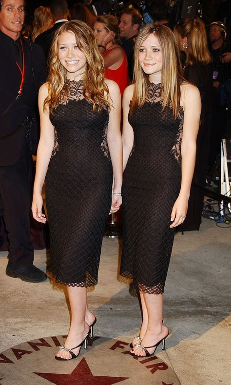 And, we're back to matching! The Olsen twins wear complementary black dresses at the Vanity Fair Oscar Party.