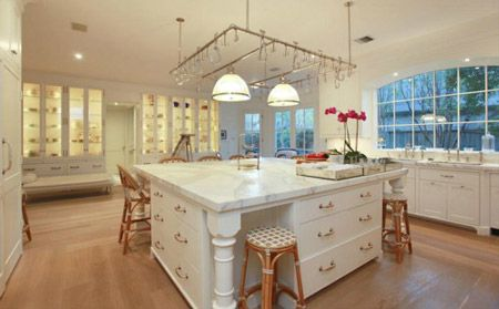Large Kitchen Island With White Drawer Storage And Seating