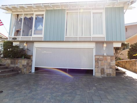 A Garage That Needs Ventilation And Privacy At The Same Time Is A Garage That Needs A Motorized Power S Garage Doors Traditional Style Homes Garage Screen Door
