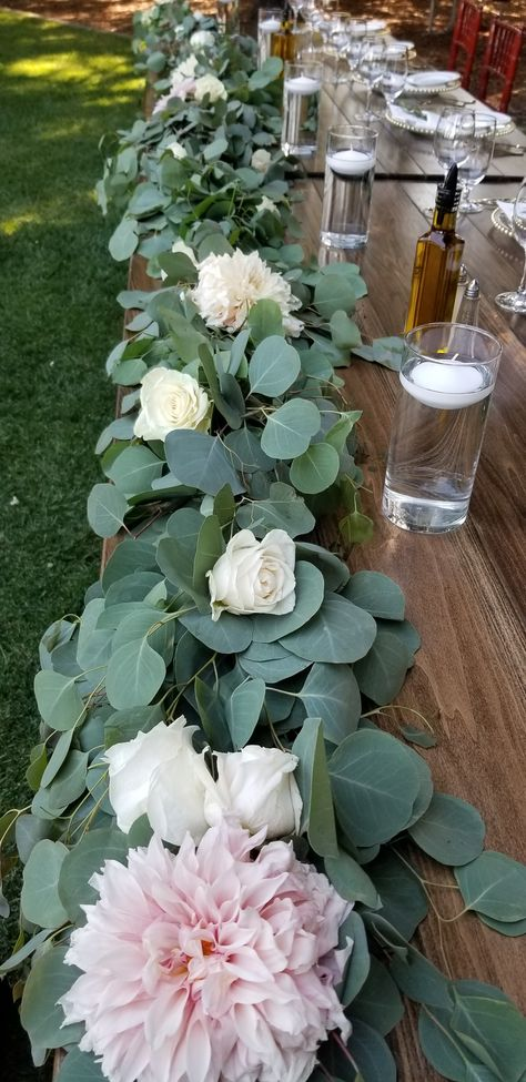 Eucalyptus garland with fresh summer dahlias and roses line the front edge of the head wedding table. #petaltownflowers #trentaduewinery #sonomaweddingflorist #garlandwithflowers #headtable #winecountryweddingflowers