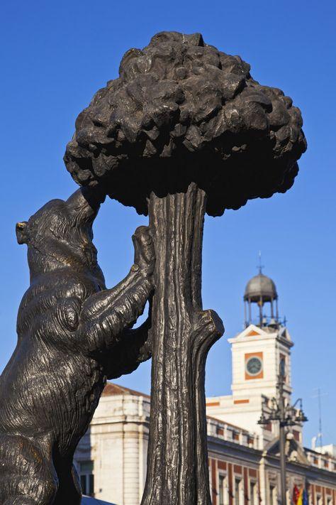 El escudo de Madrid tiene un oso y un madroño desde el siglo XIII, pues antes de que la ciudad creciera exponencialmente, los 'ositos'campaban a sus anchas por estos lares y los madroños cuajaban el paisaje. Aunque algunas fuentes afirman que es una osa en referencia a la constelación de la osa mayor. Por ello, una estatua los representa en la Puerta del Sol, de cuatro metros y de piedra y bronce, se alza en la actualidad en la entrada de la plaza por la calle de Alcalá