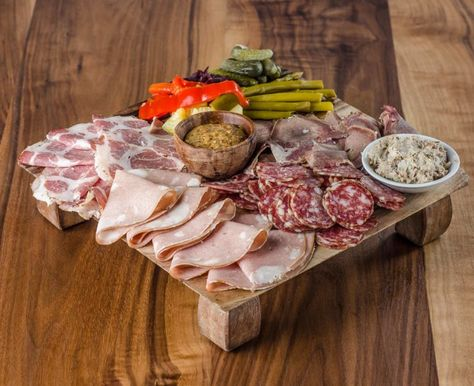Charcuterie- Selection of local and imported cured meats with housemade market pickles.