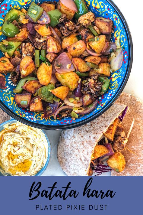 Batata hara is a delicious Lebanese dish made of fried potatoes, peppers, spices and herbs. Honestly, if this is not a part of a Lebanese restaurant menu, I feel disappointed so I decided to share this recipe. I love filling these in pita pockets or wraps as it just brings everything together with new flavors and textures. Happy Cooking! #vegetarianfood #lebaneserecipes #batatahara #veganlebanesefood #veganmezze #mezzeplatter #hummus #falafel #meditteraneanfood #veganrecipes #vegetarianrecipes