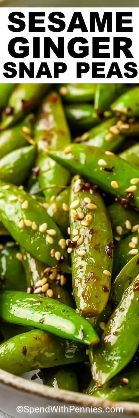 Snap Peas are sauteed in a garlic-ginger sauce, then tossed with toasted sesame seeds once they're tender! Serve with Sesame Chicken and Chow Mein for Chinese take out, made at home! #spendwithpennies #sesamegingersnappeas #recipe #sidedish #snappeas #stovetop