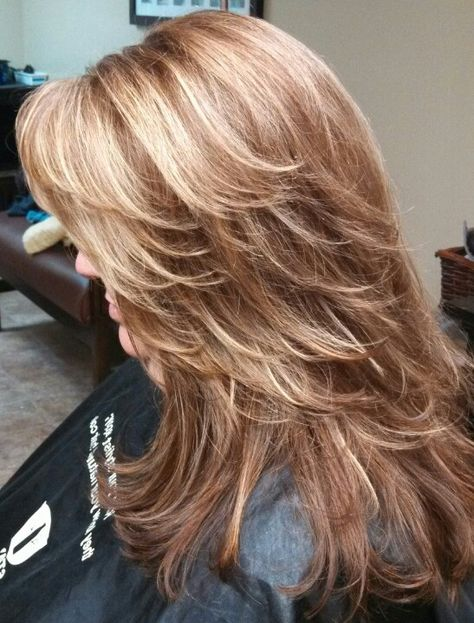 Red brown base color with heavy foils of caramel/ blonde hi lights....perfect for summer! Thx Barb!