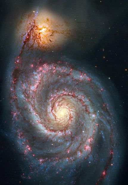 This NASA image shows NGC 5194. M51's stretch of over 60,000 light-years dwarf its companion galaxy, NGC 5195. Credit: Hubble Space Telescope, NASA.