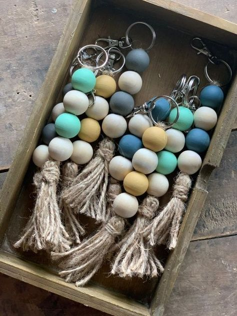 Use for your keys, bag purse accessory, or give as a gift! The wood beads are 20 mm in size. The colored beads are hand painted, using chalk paint. The other beads are the natural wood color. The tassel is made from jute twine. Wood Bead Garland, Beaded Garland, Beaded Ornaments, Diy Garland, Diy Ornaments, Glass Ornaments, Bead Crafts, Diy And Crafts, Arts And Crafts