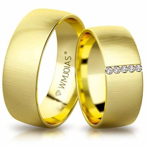 351c6f8c82a70 Modelo  Aliança de noivado e casamento Material  Ouro Amarelo 18k 750 Peso   16 gramas Pedra(s)  5 Zircônias White Largura  7.5 milímetros Formato   Anatômico ...