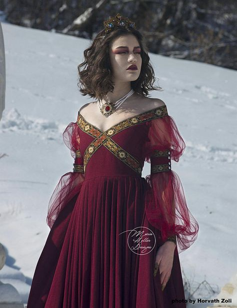 Renaissance inspired burgundy dress. This gown is called Emaleth. This design was created by me and I made the patterns. The top has an off the shoulder boat neckline and an X in the front featuring a beautifully decorated trim which goes all around the back. The same trim