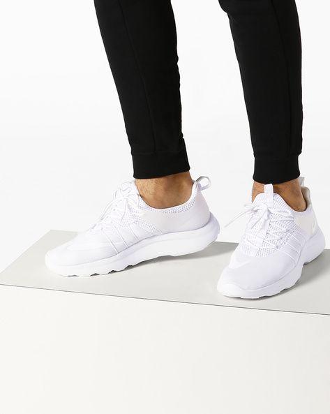 fb2ae5c1bad Buy NIKE Men White Darwin Running Shoes | AJIO | clothing | Shoes ...