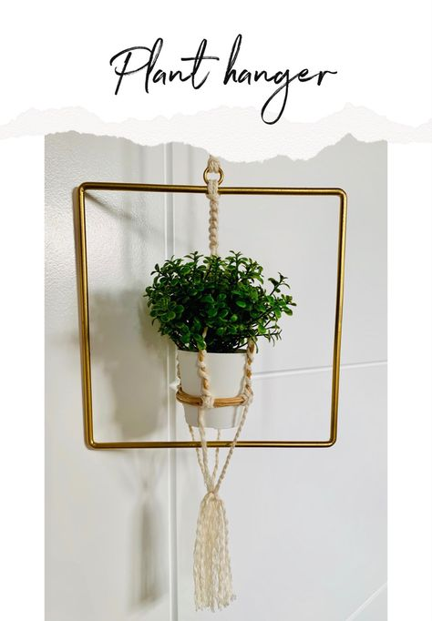 Using a square and macrame to create this plant holder.