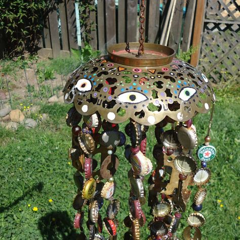 Recycled wind chimes restore beautiful objects that are nostalgic and constantly changing purpose. Every key has been used and lost by the original owner. All fishing line has been gathered from beach shores. Even the beads have been reused from unworn necklaces.