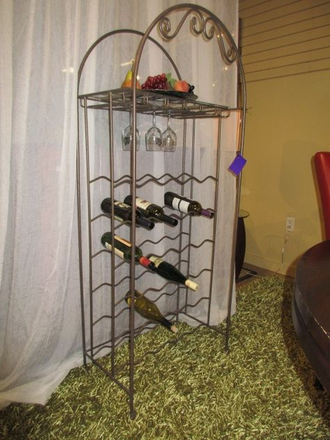 "Metal wine rack in a bronze finish. Great amount of storage for a wine rack this size! This piece can hold up to 36 bottles. There is one shelf at the top. Measures 25""wide x 15""deep x 60""high. Arrived: Friday September 9th, 2016"