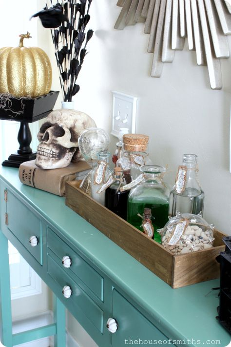 Halloween Entryway Table decor - thehouseofsmiths.com| Love the square box on stand painted black....potion bottles also