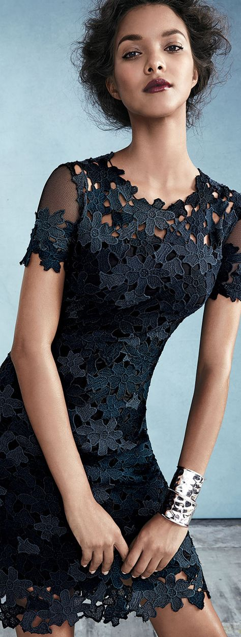 """Elie Tahari """"Ophelia"""" floral lace dress. Approx. length: 37""""L down center back. Jewel neckline. Short mesh sleeves. Sheath silhouette. Back zip. Polyester. Dry clean. Imported."""