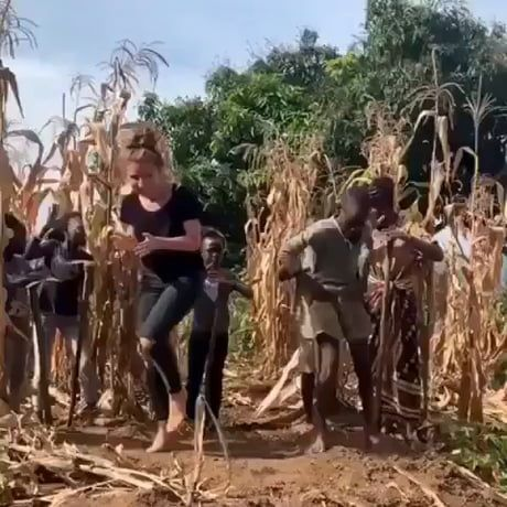 Foreigner dances with village boy