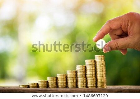 Stock Photo Man Hand Hold A Coin With Working Capital Management Put On The Wood In The Public Park Saving Money For Fu Personal Loans Saving Money Investing