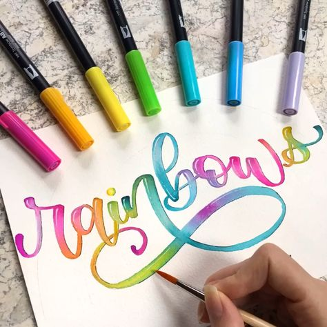 Created by Lyssa's Letters - @lyssas_letters on Instagram. The vibrant colors of Tombow dual brush pens lend themselves perfectly to creating rainbow lettering art! Fortunately, these brush pens have water-based ink and can be used like watercolor paints. Check out this blog post to see how I created this fun, easy rainbow brush lettering artwork using my Tombows on watercolor paper! #diy #handlettering #calligraphy #pinittowinit2019 #pinittowinit