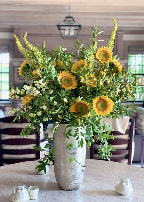 A bright and uplifting floral arrangement of sunflowers and eremurus with snowberry and passion vine accents Designed by KD J Botanica Sunflower Floral Arrangements, Fall Arrangements, Beautiful Flower Arrangements, Fresh Flower Arrangement, Summer Flower Arrangements, Church Flowers, Fall Flowers, Fresh Flowers, Beautiful Flowers
